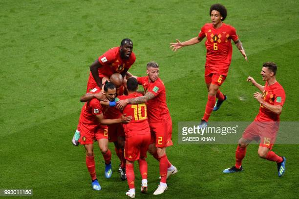 Belgium's players celebrate Brazil's own goal during the Russia 2018 World Cup quarter-final football match between Brazil and Belgium at the Kazan...