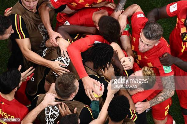 TOPSHOT Belgium's players celebrate their second goal during the Russia 2018 World Cup round of 16 football match between Belgium and Japan at the...