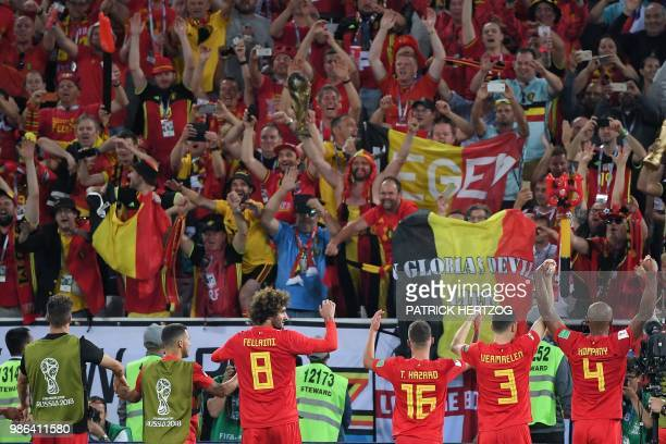 Belgium's players celebrate with fans at the end of the Russia 2018 World Cup Group G football match between England and Belgium at the Kaliningrad...