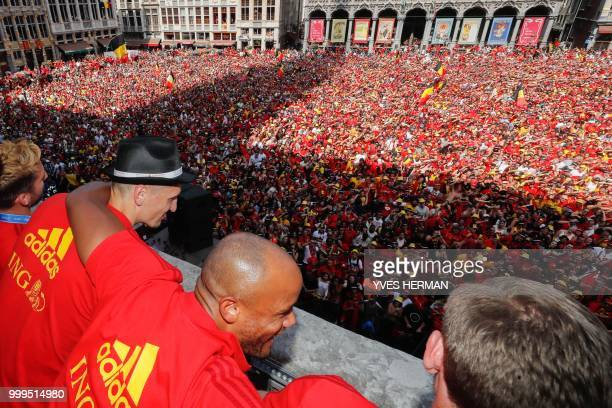 Belgium's players Dries Mertens Thomas Meunier Vincent Kompany and Jan Vertonghen celebrate at the balcony in front of more than 8000 supporters at...