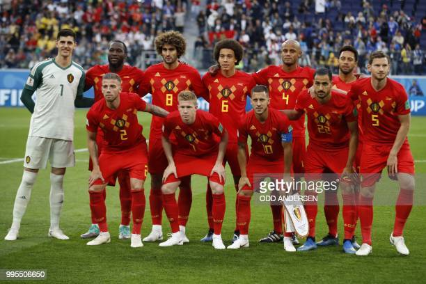 Belgium's players goalkeeper Thibaut Courtois forward Romelu Lukaku midfielder Marouane Fellaini midfielder Axel Witsel defender Vincent Kompany...