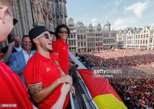 Belgium's players Kevin De Bruyne Eden Hazard and Axel Witsel celebrate at the balcony in front of more than 8000 supporters at the GrandPlace Grote...