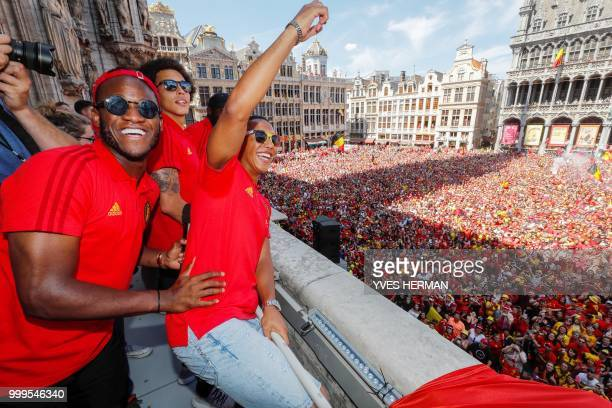 Belgium's players Michy Batshuayi Axel Witsel and Youri Tielemans celebrate at the balcony in front of more than 8000 supporters at the GrandPlace...