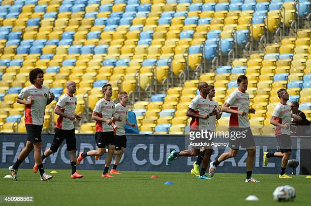Belgium's players practise during a training session at the Maracana Stadium in Rio de Janeiro Brazil on June 21 2014 Belgium will play against...