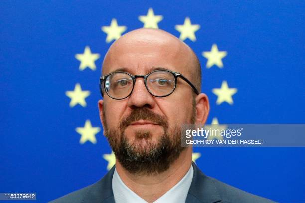 TOPSHOT Belgium's Prime Minister Charles Michel looks on as he addresses the media after the EU leaders struck a deal on the bloc's top jobs during...