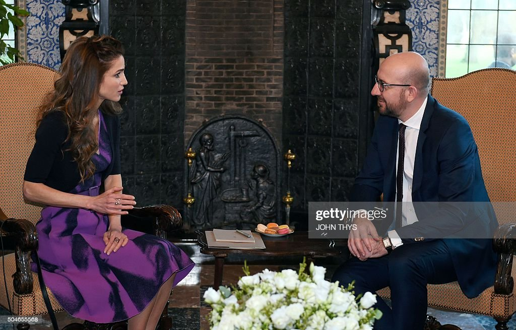 Belgium's Prime Minister Charles Michel (R) speaks with Jordan's Queen Rania before a meeting on the Syrian refugee crisis in Brussels on January 12, 2016. / AFP / JOHN