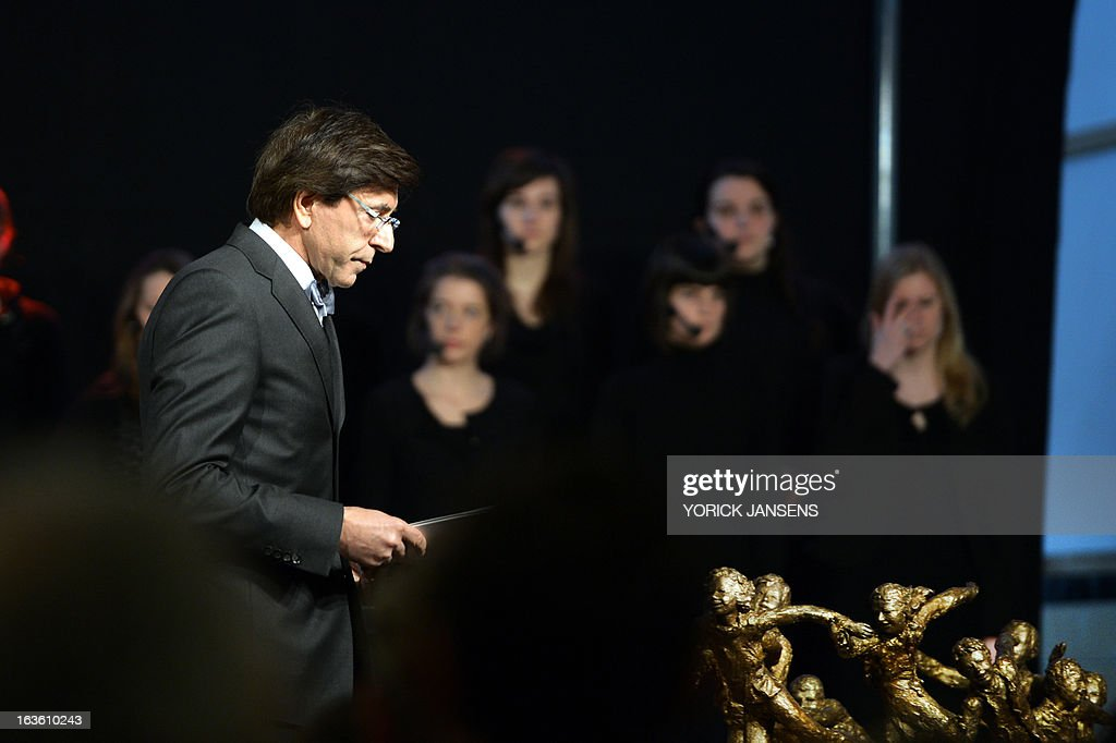 Belgium's Prime Minister Elio Di Rupo (L) attends a remembrance service on March 13, 2013 in Heverlee, to commemorate the bus crash in Sierre, Switzerland, a year ago. In the evening of March 13, 2012 a bus accident occurred in a tunnel in Sierre, Valais, Switzerland, killing 28 people, including 22 children, and injuring 24 others. The children from the Stekske primary school in Lommel and Sint-Lambertus school in Heverlee were on their way home from a ski vacation. OUT -