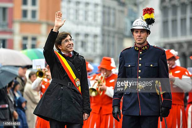 Belgium's Prime Minister Elio Di Rupo waves at the crowd during the Ducasse Doudou folkloric festival in Mons on June 3 2012 In 2005 UNESCO declared...