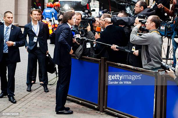 Belgium's Prime Minister Elio Di Rupo while answering a question to the press, adjusting his trousers, before an EU summit in Brussels on Friday,...