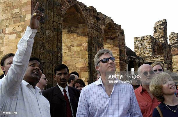 Belgium's Prince Philippe stands with a delegation of officials as he listens to an official from the Archaeological Survey of India describe...