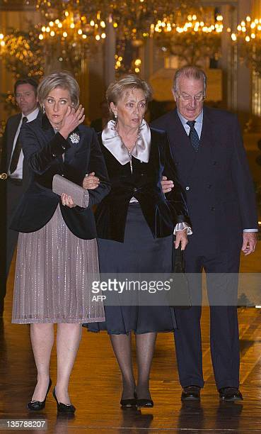 Belgium's Princess Astrid, Queen Paola and King Albert II arrives to the yearly Christmas Concert at the Royal Palace in Brussels on December 14,...