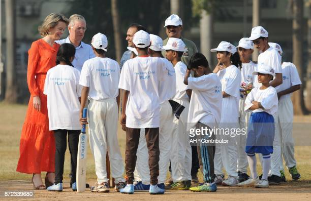 Belgium's Queen Mathilde and King Philippe interact with school children during a UNICEF cricket clinic with former Indian cricketer Virender Sehwag...