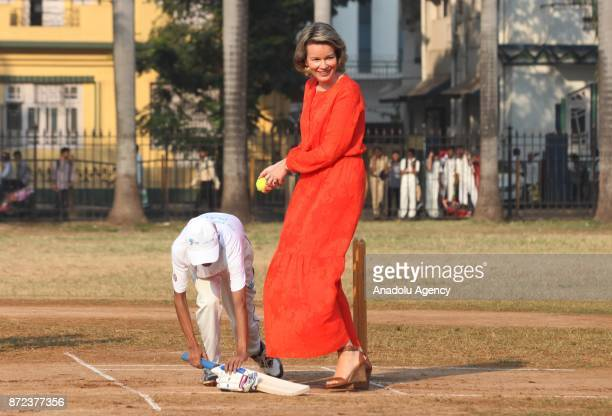 Belgium's Queen Mathilde hits a ball as she plays cricket with children at a ground in Mumbai India November 10 2017