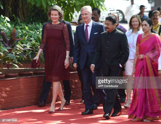 Belgium's Queen Mathilde King Philippe the Governor of the western Indian state of Maharashtra Ch Vidyasagar Rao and his wife Vinodha walk during an...