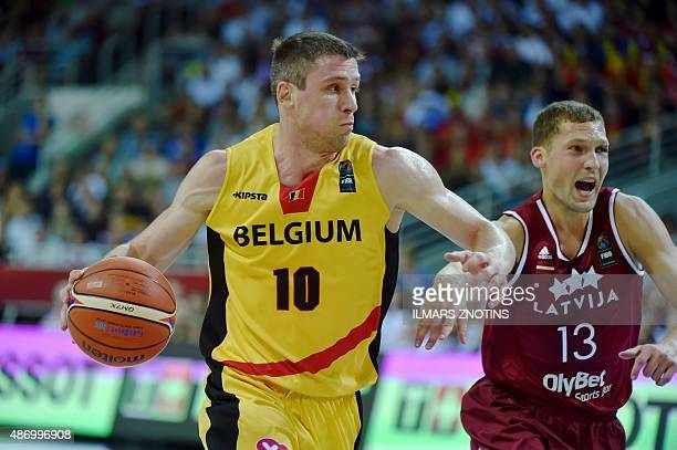 Belgium's Quentin Serron fights for the ball with Latvia's Janis Strelnieks during the Eurobasket 2015 group D basketball match Belgium vs Lithuania...