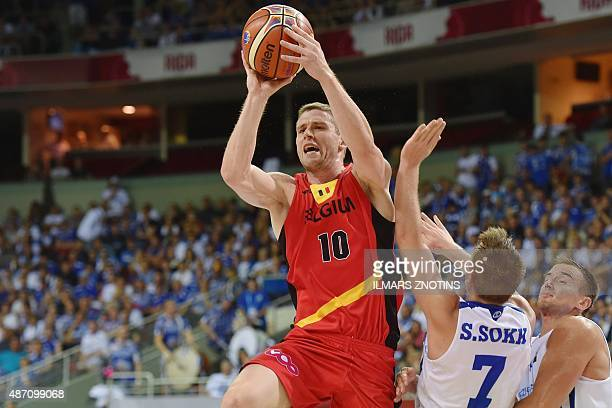 Belgium's Quentin Serron vies for the ball with Estonia's Sten Sokk and Gregor Arbet during the Eurobasket 2015 group D basketball match Belgium vs...