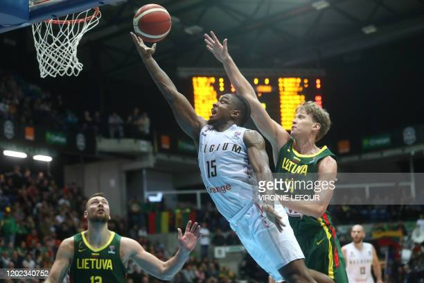 Belgium's Retin Obasohan and Lithuania's Mindaugas Kuzminskas fight for the ball during the match between the Belgian Lions and Lithuania, game one...