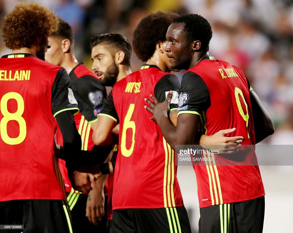 Belgium's Romelu Lukaku (R) celebrates with his teammate Axel Witsel after scoring a second goal during the World Cup 2018 Europe qualifying football match Cyprus versus Belgium on September 6, 2016 at the GSP Stadium in Nicosia. / AFP / Sakis Savvides