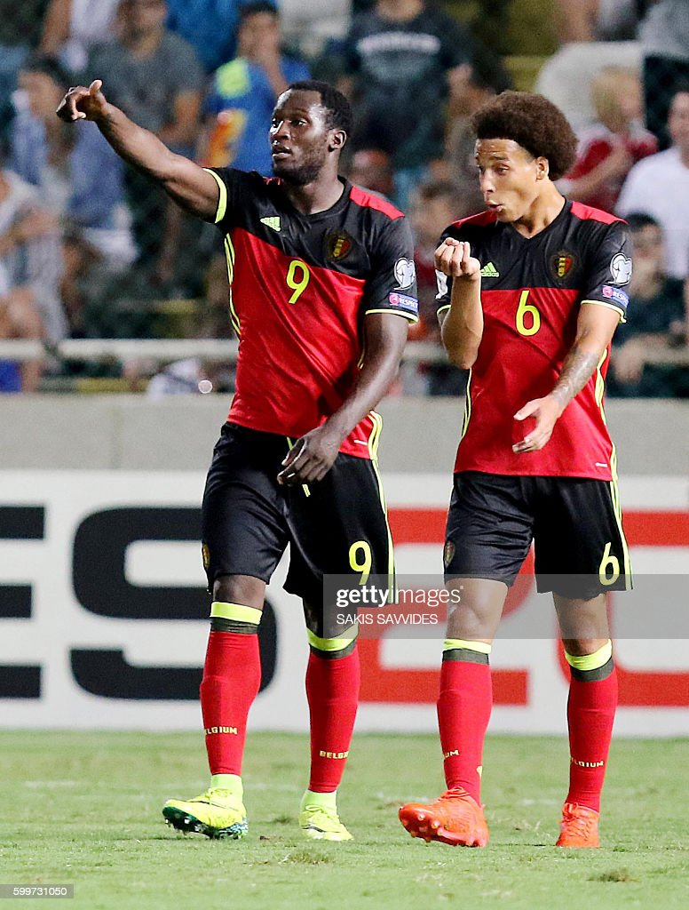 Belgium's Romelu Lukaku (L) celebrates with his teammate Axel Witsel after scoring a second goal during the World Cup 2018 Europe qualifying football match Cyprus versus Belgium on September 6, 2016 at the GSP Stadium in Nicosia. / AFP / Sakis Savvides