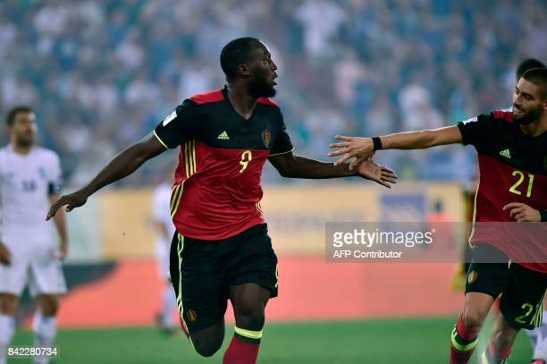 Belgium's Romelu Lukaku celebrates with teammate Yannick Carrasco after scoring during their Group H 2018 FIFA World Cup qualifying football match...