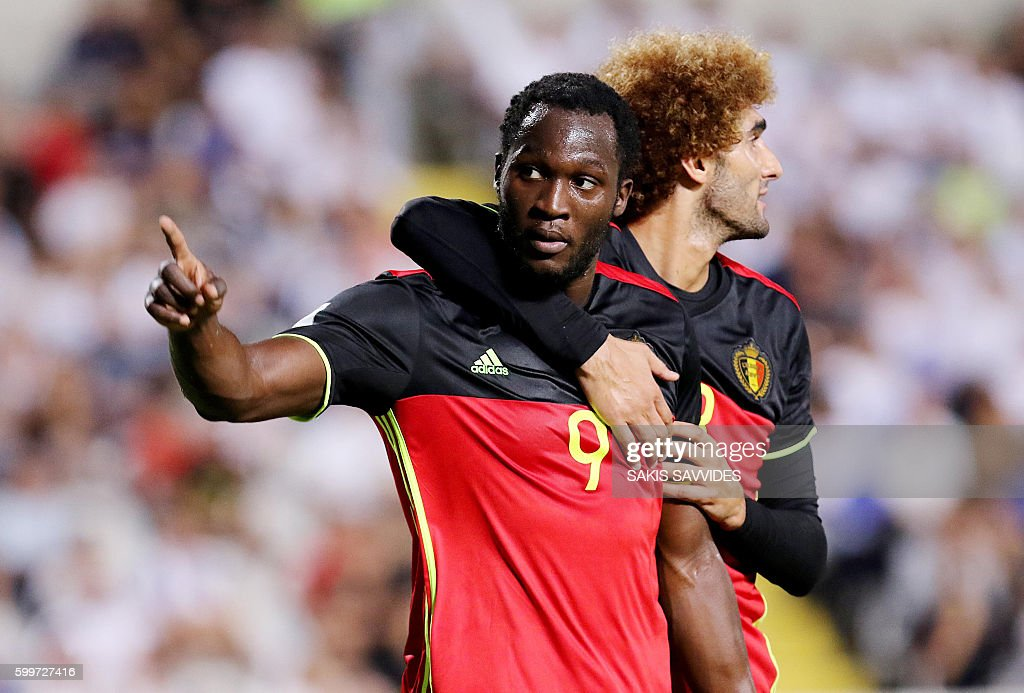 Belgium's Romelu Lukaku (L) is congratulated by teammates after he scored a goal during the World Cup 2018 Europe qualifying football match Cyprus versus Belgium on September 6, 2016 at the GSP Stadium in Nicosia. / AFP / Sakis Savvides