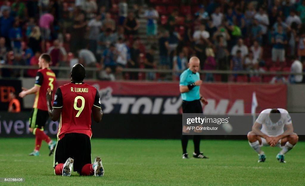 Belgium's Romelu Lukaku (L) reacts at the end of the Group H 2018 FIFA World Cup qualifying football match between Greece and Belgium at The Georgios Karaiskakis Stadium in Piraeus near Athens on September 3, 2017. /