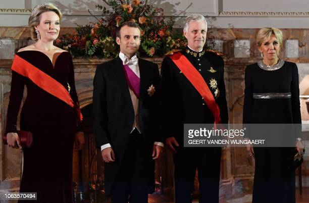 Belgium's royal couple Philippe of Belgium and Mathilde of Belgium French President Emmanuel Macron and his wife Brigitte Macron pose for...