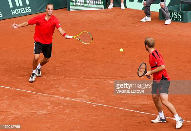 Belgium's Ruben Bemelmans and Olivier Rochus compete against Sweden's Johan Brunstroem and Michael Ryderstedt during the third match of the Davis Cup...