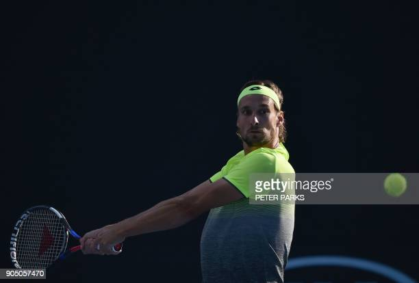 Belgium's Ruben Bemelmans plays a backhand return to France's Lucas Pouille during their men's singles first round match on day one of the Australian...