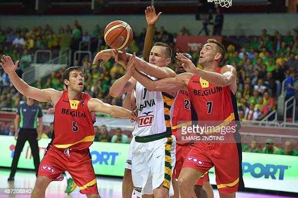 Belgium's Sam Van Rossom and Axel Hervelle vie for the ball with Lithuania's Paulius Jankunas during the Eurobasket 2015 group D basketball match...