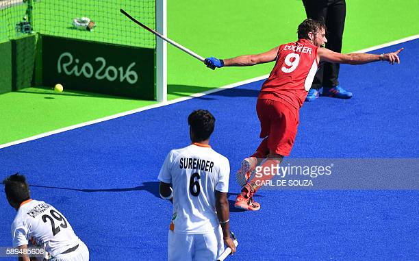 Belgium's Sebastien Dockier celebrates a goal during the men's quarterfinal field hockey Belgium vs India match of the Rio 2016 Olympics Games at the...
