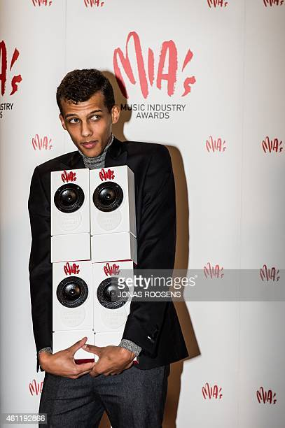 Belgium's singer Stromae poses with his 4 awards at the MIA award show, in Lint, on January 8, 2015. The MIA awards are handed out by the VRT and the...