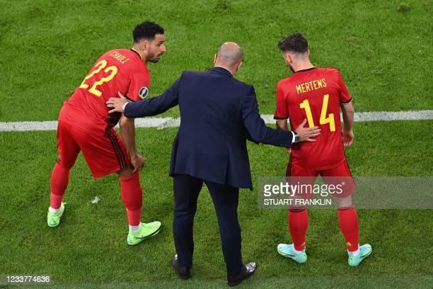 Belgium's Spanish coach Roberto Martinez prepares to bring on Belgium's midfielder Nacer Chadli and Belgium's forward Dries Mertens during the UEFA...