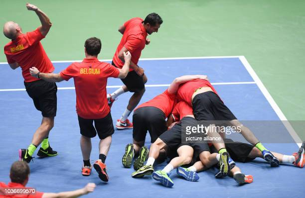 Belgium's Steve Darcis and his team cheer about his victory over Germany's Zverev during the Davis Cup tennis match between Germany and Belgium at...