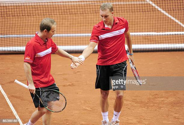 Belgium's Steve Darcis and Olivier Rochus react during their doubles Davis Cup tennis match against Poland's Marcin Matkowski and Grzegorz Panfil on...