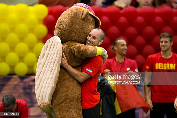 Belgium's Steve Darcis celebrates after winning the tennis match against Brazil's Thomaz Bellucci, the second game of the Davis Cup World Group...