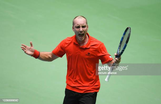 Belgium's Steve Darcis celebrates during the Davis Cup World Group match between Germany and Belgium at the Fraport Arena in Frankfurt/Main, Germany,...