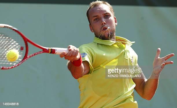 Belgium's Steve Darcis hits a return to Spain's Fernando Verdasco during their Men's Singles 1st Round tennis match of the French Open tennis...