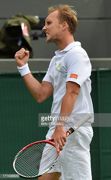 Belgium's Steve Darcis reacts after a point won against Spain's Rafael Nadal during their men's first round match on day one of the 2013 Wimbledon...