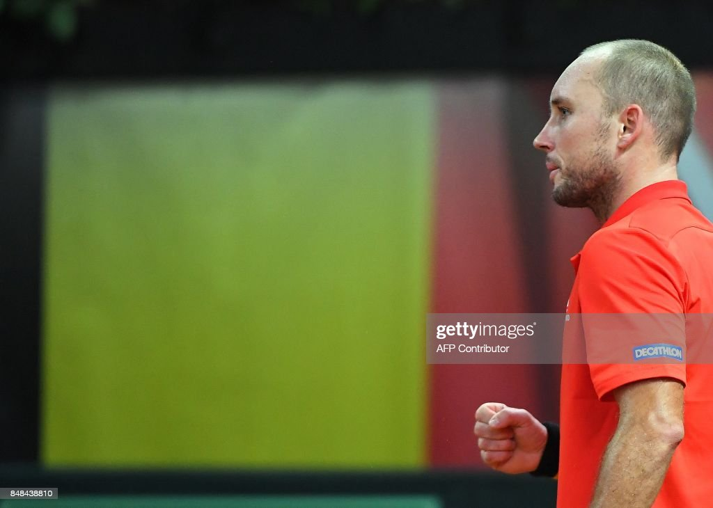 Belgium's Steve Darcis reacts after scoring against Australia's Jordan Thomson during the Davis Cup semifinal tennis match between Belgium and Australia in Brussels on September 17, 2017. /