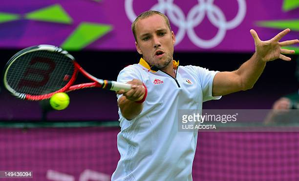 Belgium's Steve Darcis returns to Cezch Republic's Tomas Berdych during the men's singles Tennis match at the London 2012 Olympic Games in London on...