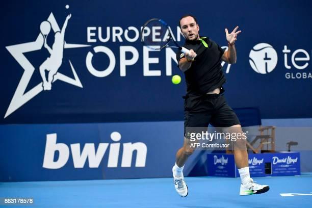 Belgium's Steve Darcis returns to Spain's David Ferrer during their Antwerp tennis tournament quarterfinal match on October 19 2017 in Antwerp / AFP...