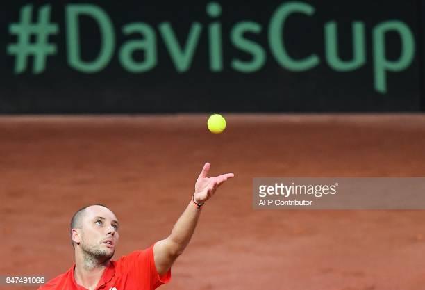 Belgium's Steve Darcis serves against Australia's Nick Kyrgios during the Davis Cup semifinal tennis match between Belgium and Australia in Brussels...