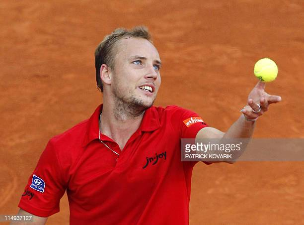 Belgium's Steve Darcis serves to France's Gael Monfils during their men's third round match in the French Open tennis championship at the Roland...