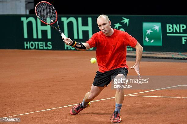 Belgium's Steve Darcis takes part in a training session ahead of the Davis Cup World Group final between Belgium and Britain, on November 24 at...