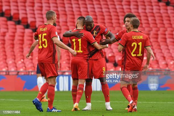 Belgium's striker Romelu Lukaku is congratulated after scoring a penalty for the opening goal during the UEFA Nations League group A2 football match...