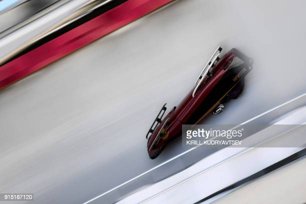 TOPSHOT Belgium's team leader and driver An Vannieuwenhuyse crashes in the first women's unofficial bobsleigh training session at the Olympic Sliding...