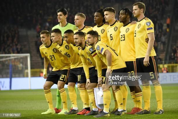 Belgium's team players Belgium's defender Timothy Castagne Belgium's forward Thorgan Hazard Belgium's midfielder Youri Tielemans Belgium's forward...