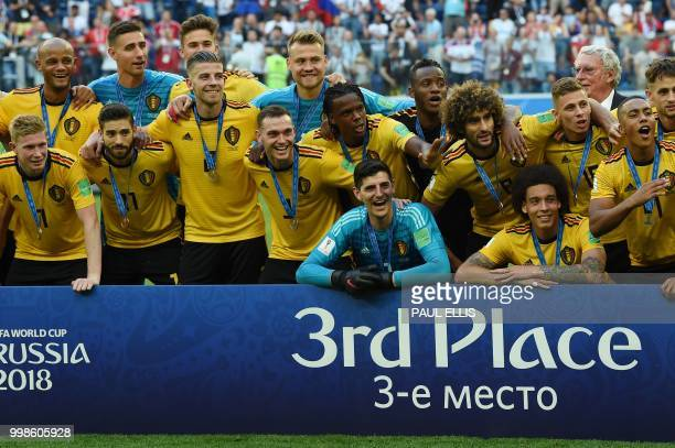 TOPSHOT Belgium's team pose with their medals after winning their Russia 2018 World Cup playoff for third place football match between Belgium and...