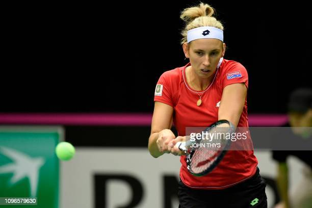 Belgium's tennis player Elise Mertens returns the ball to France's tennis player Alize Cornet during the FedCup World Group first round tennis match...